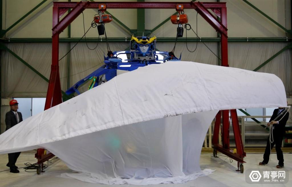 """New transforming robot called """"J-deite RIDE"""" that transforms itself into a passenger vehicle, developed by Brave Robotics Inc, Asratec Corp and Sansei Technologies Inc, is unveiled at a factory near Tokyo"""