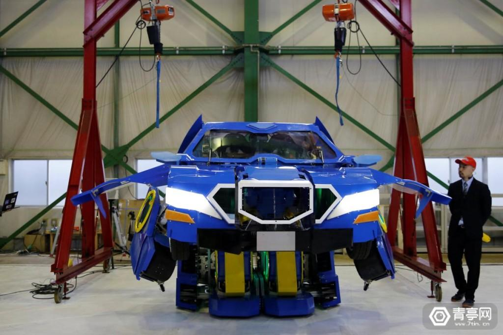 """New transforming robot called """"J-deite RIDE"""" that transforms itself into a passenger vehicle, developed by Brave Robotics Inc, Asratec Corp and Sansei Technologies Inc, demonstrates during its unveiling at a factory near Tokyo"""